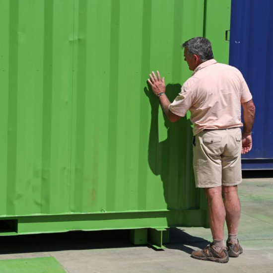 Inspecting the paint for a shipping container conversion